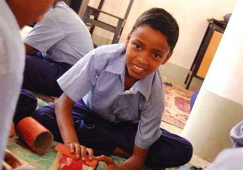 Kolkata Compassion boy making a pencil holder