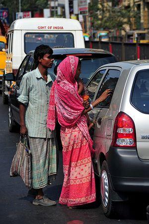 woman, child, blind beggars on Calcutta streets