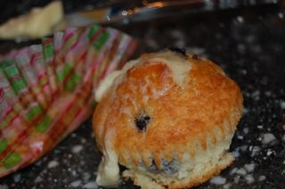 Blueberry muffin with melted butter