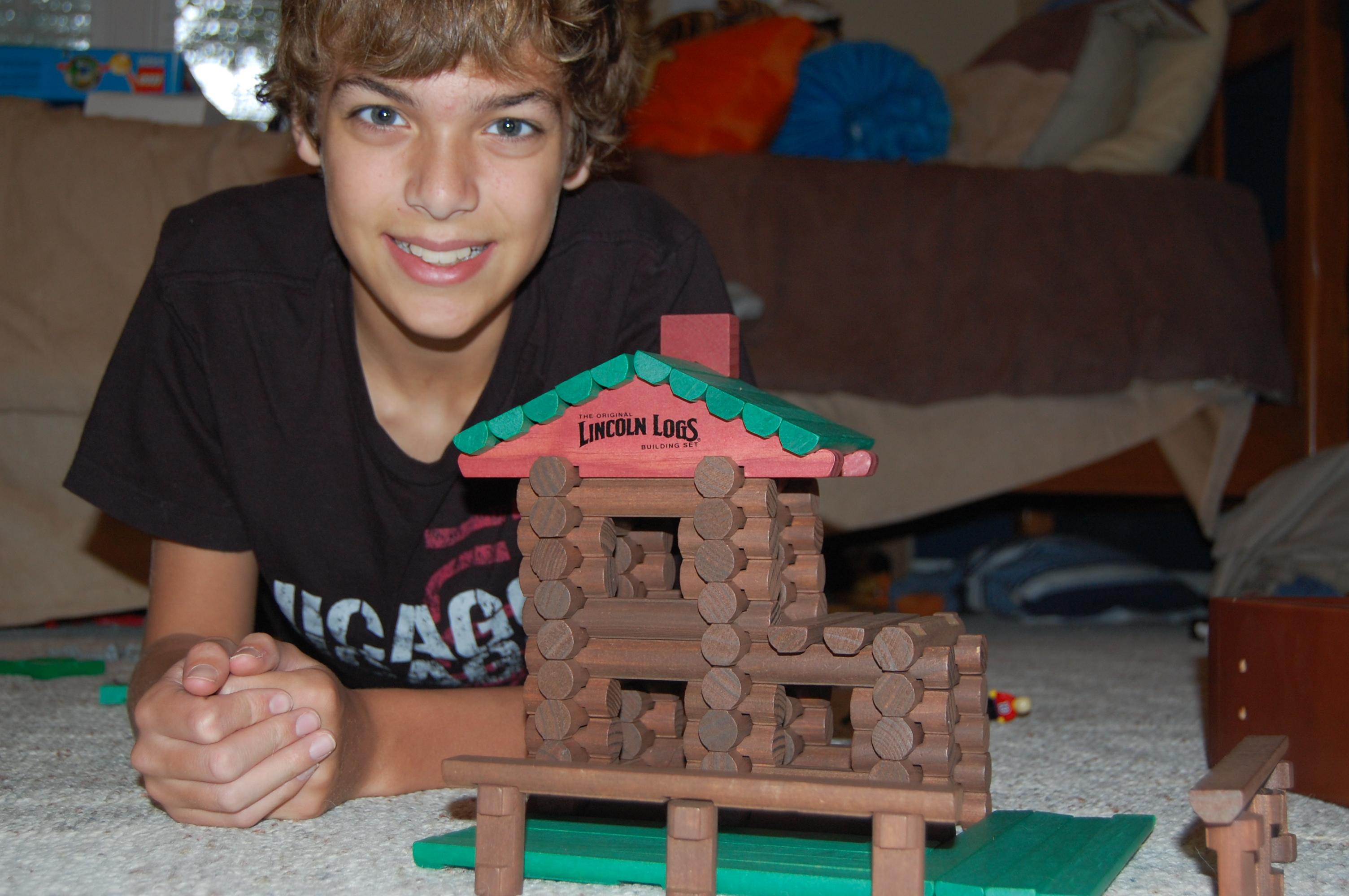 son building with Lincoln Logs