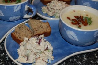 Cranberry Chicken Salad, Potato Leek Soup, Banana Nut bread on soup plates