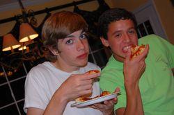 Teen boys eating pizza