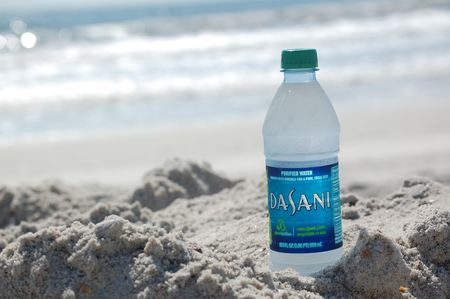 Dasani water bottle on the beach