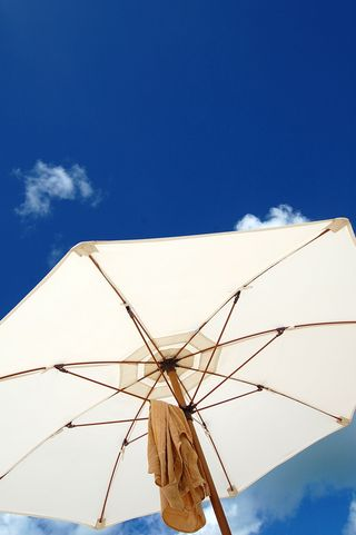 Beach umbrella under blue Antiguan skies :)