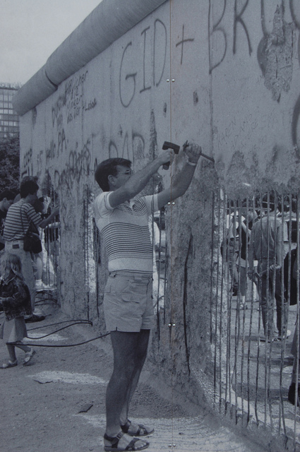 Man chipping away the Berlin Wall