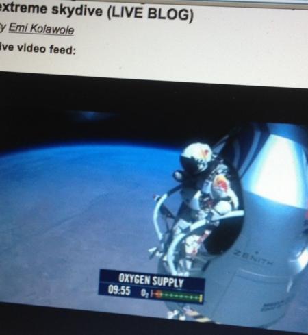 Felix Baumgartner, 24 miles above earth, standing at Stratos capsule door
