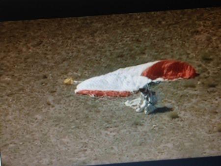 Felix Baumgartner, praying, falling to his knees upon landing